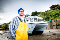 Skipper Ben Bengey with his boat in Infracombe
