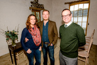 Lara Gill and Matthew Stokes, owners of Launcells Barton near Bude in the wedding venue's barn with, right, Tim Burston from Lloyds Bank.
